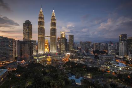 Petronas towers in Kuala Lumpur, Malaysia by nightfall