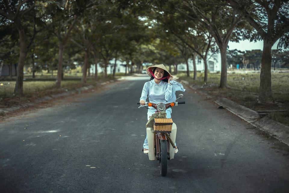 Woman driving a motor bike in Vietnam