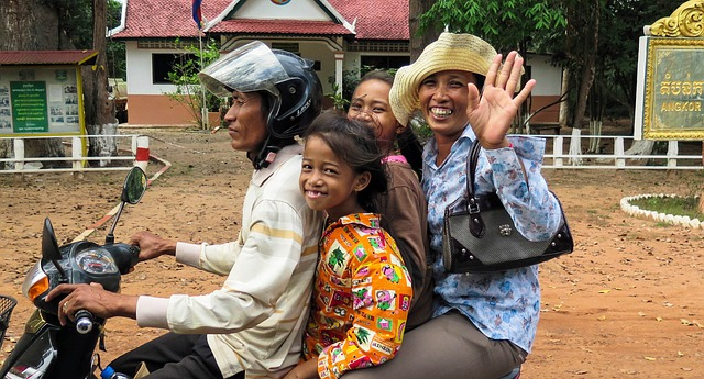 Smiling and waving locals in Siem Reap